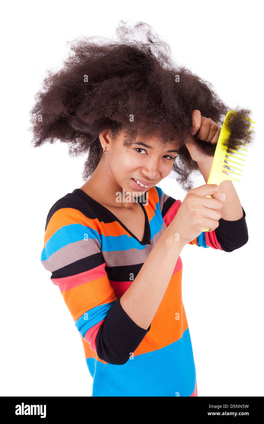 Black African American teenage girl combing her afro hair, isolated on  white background - Stock