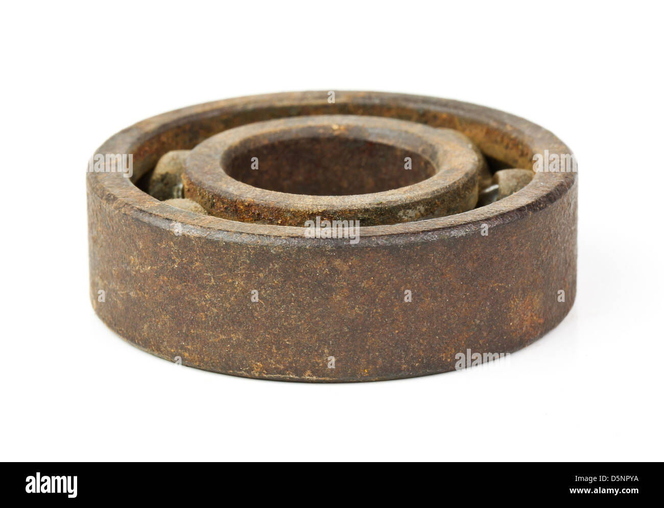 Rusted bearing isolated on white background - Stock Image