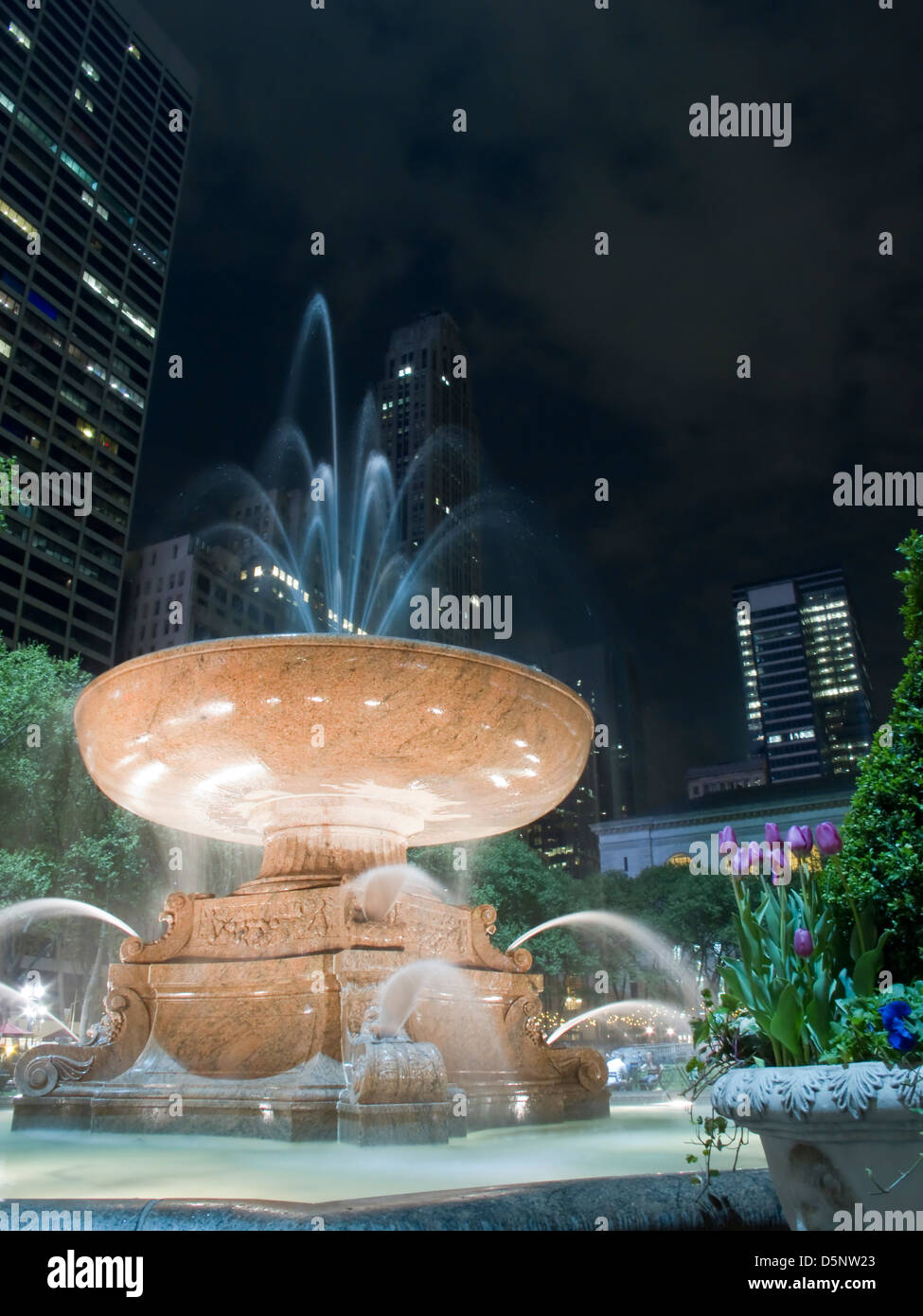 Illuminated Water Fountain at Night (Motion Blur) - Stock Image