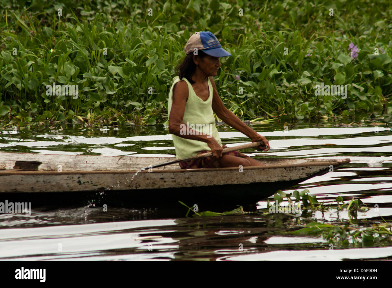 local woman at traditional canoe, somewhere out periphery of Manau, amazonas, Brazil - Stock Image