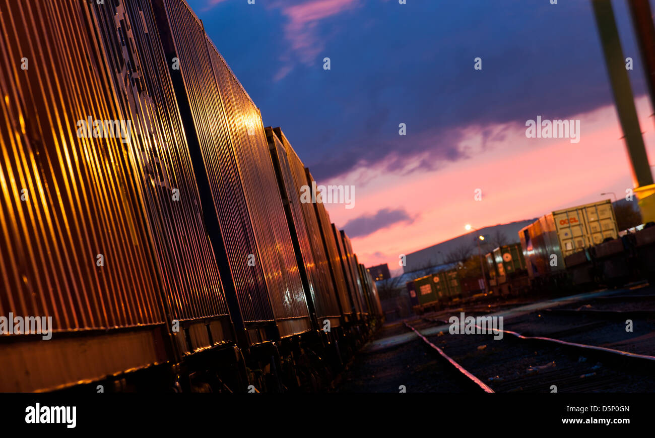 Beautiful view of freight train waiting at Manchester Freightliner railway freight terminal at dusk. Stock Photo