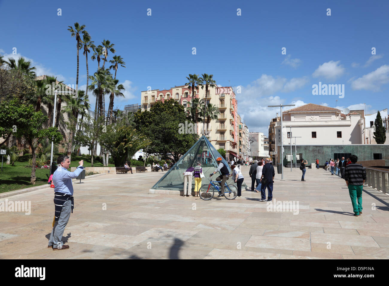Tourists in front of the Roman Theater Ruin in Malaga, Andalusia Spain - Stock Image