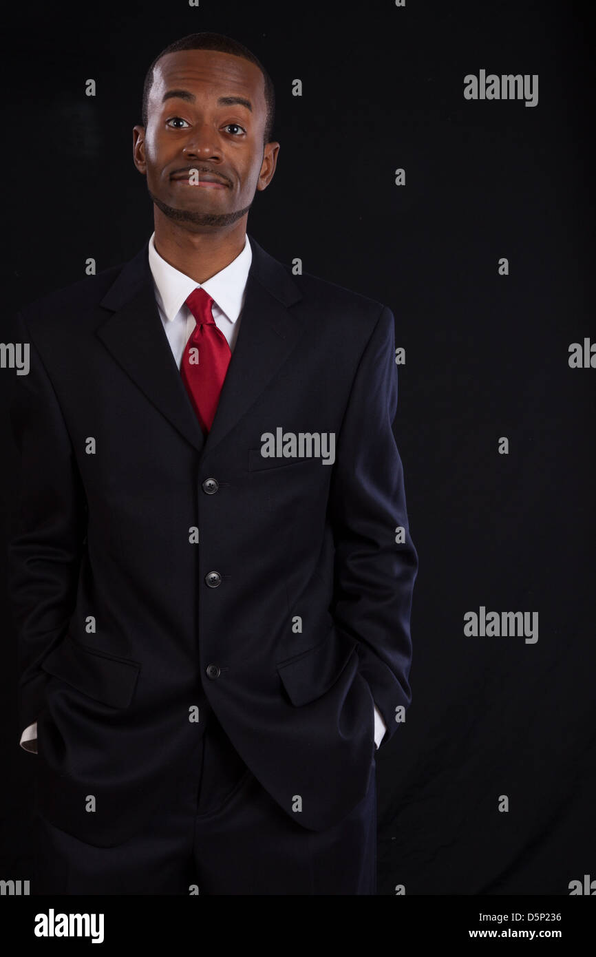 46c3502c449c Black man in dark suit, white shirt and red tie, a successful, prosperous  businessman, looking pleased with himself