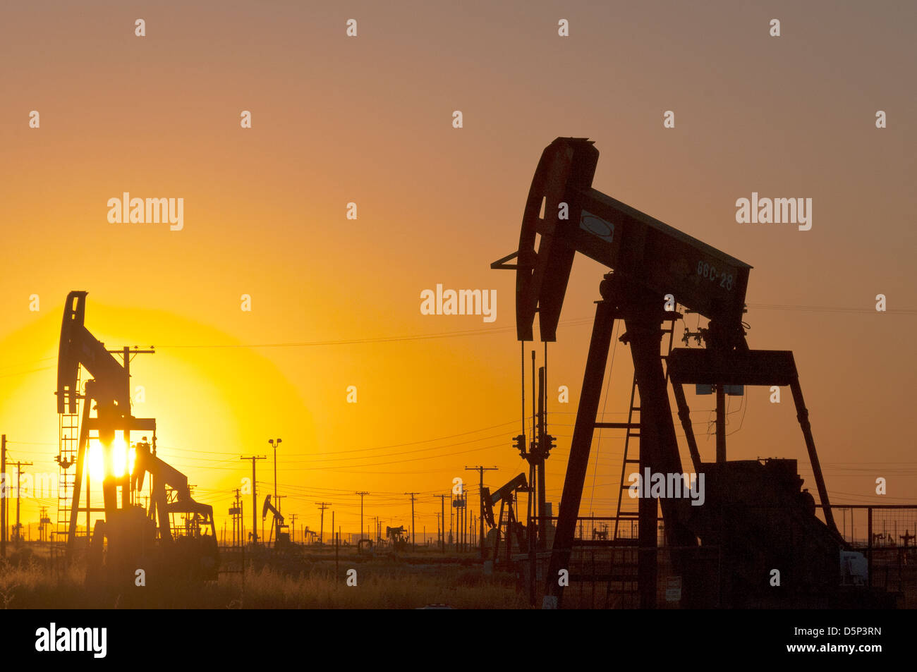 Oil pumps at sunset in California - Stock Image