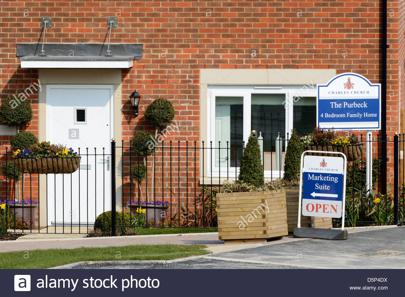 Charles Church Show Home with marketing signs, Blandford Forum, Dorset, England - Stock Image