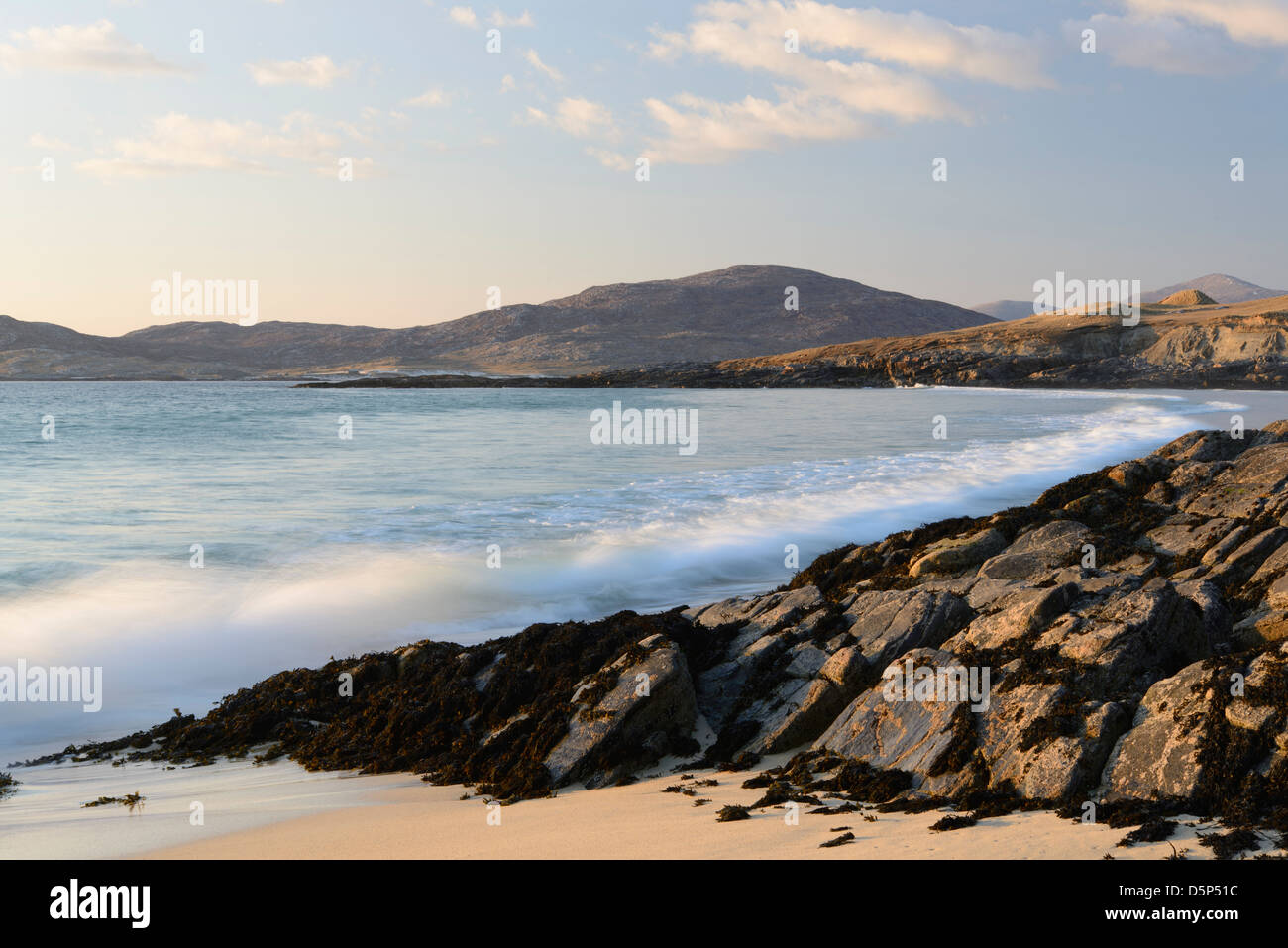 Waves crash upon the rocks at Traigh Lar on the Isle Harris, Outer Hebrides - Stock Image