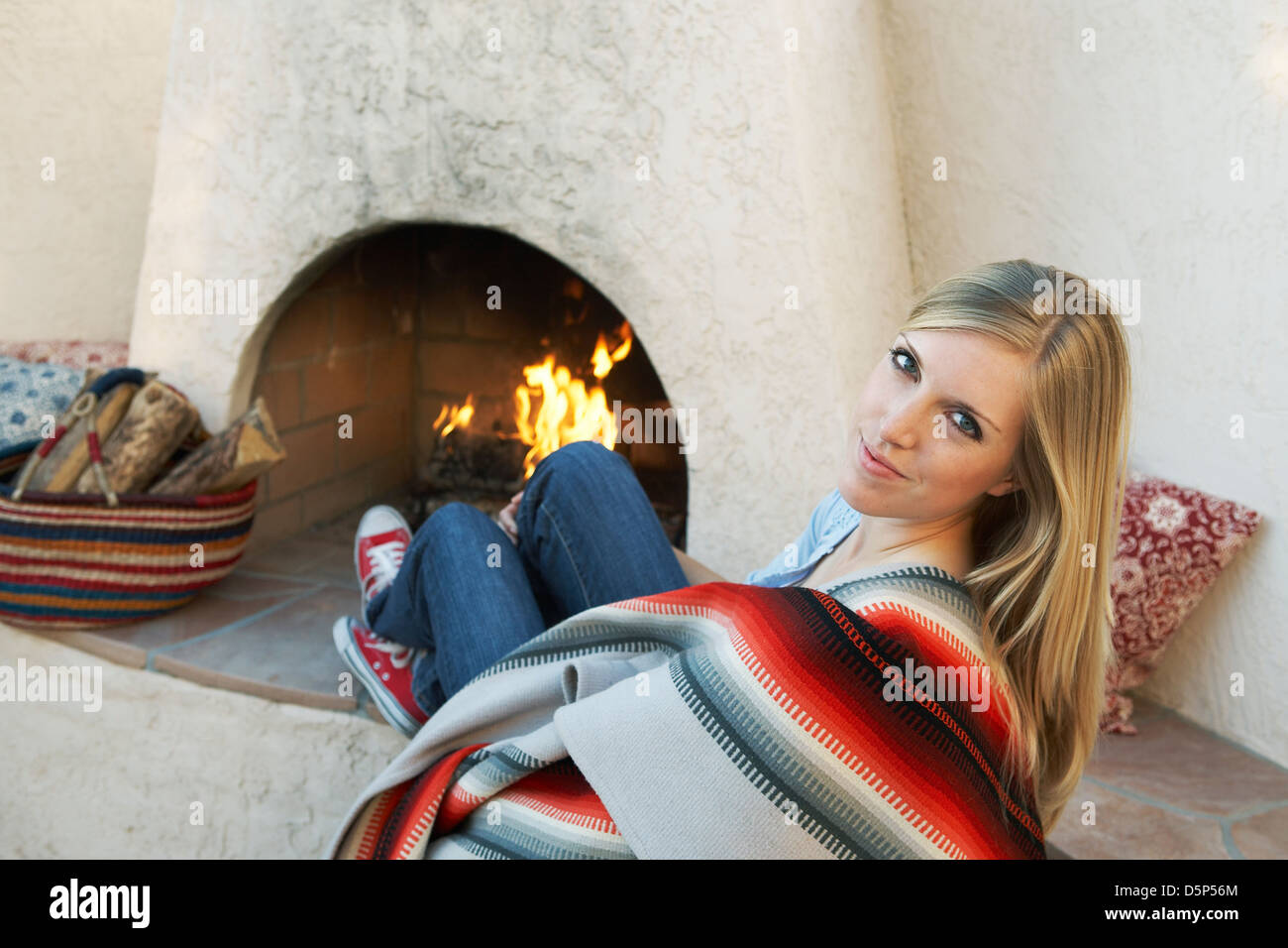 21 year old woman in front of outdoor southwest fireplace - Stock Image