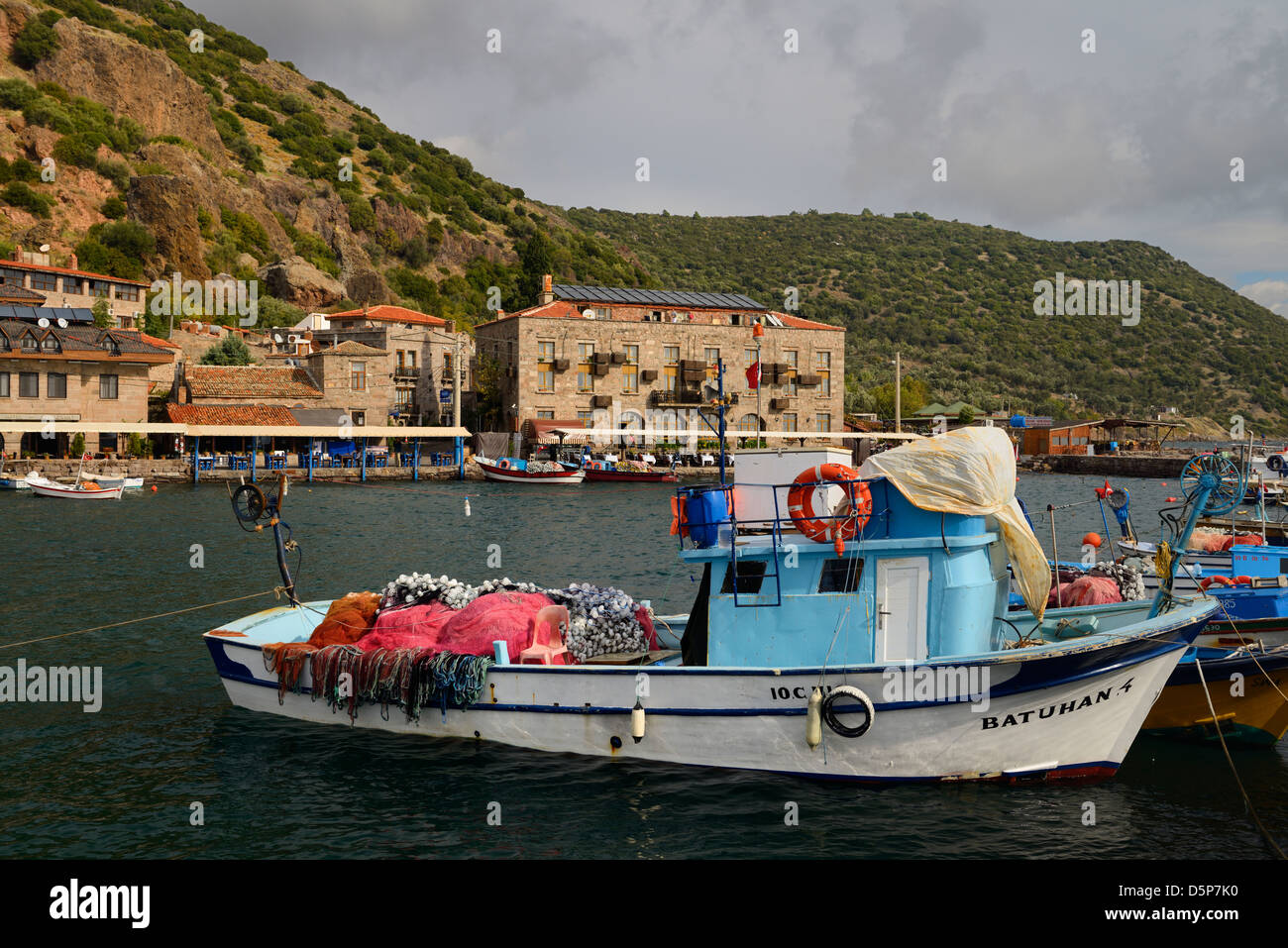 Seaside village hamlet of Assos Iskele or Behram Turkey with boats hotels and restaurants on the Aegean Sea - Stock Image