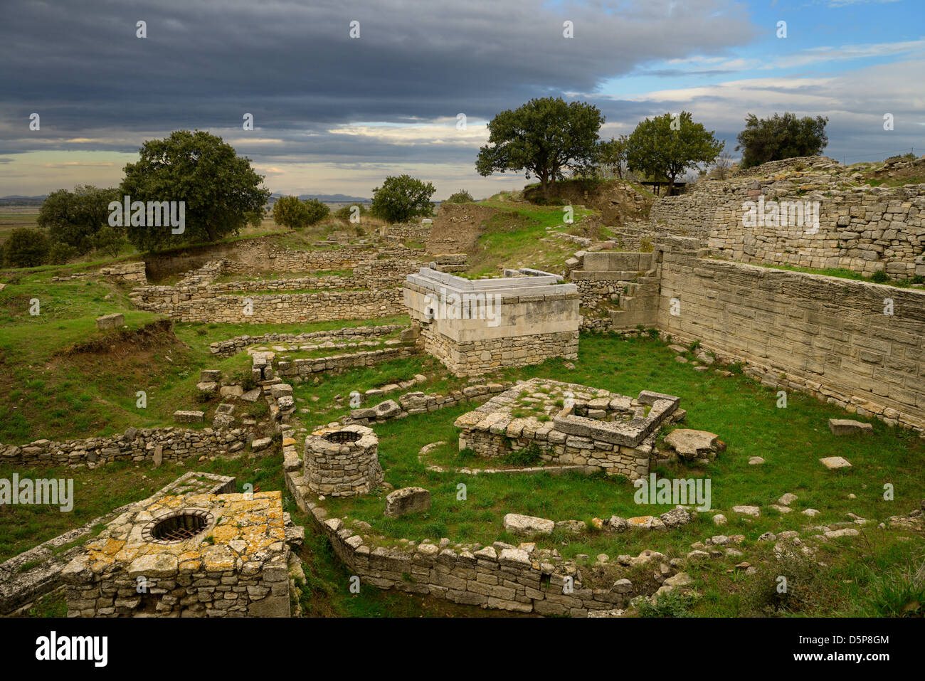 Sanctuary walls and wells of Troy VI at archeological site near Hisarlik Turkey - Stock Image