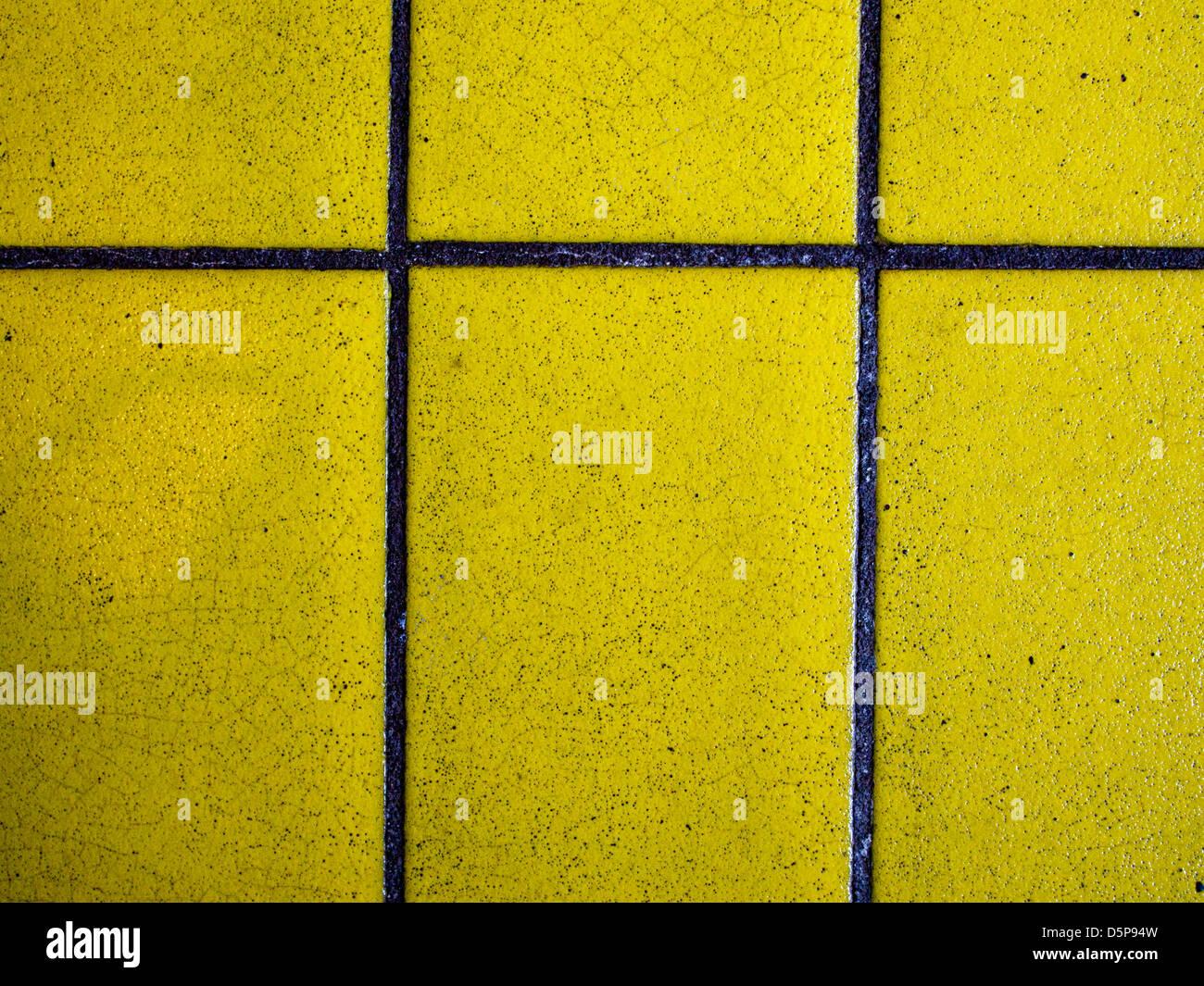 yellow vintage tile - Stock Image