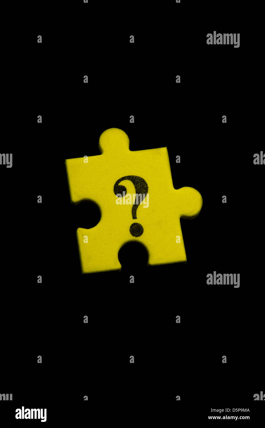 Isolated question mark puzzle textured yellow piece - Stock Image