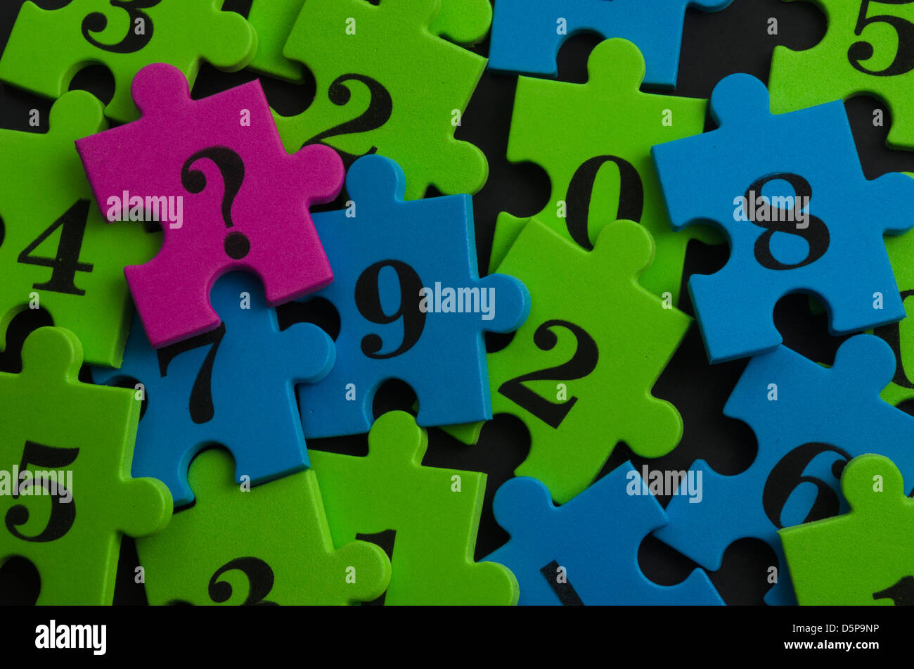 Math colorful puzzle pieces of numbers and a question mark - Stock Image