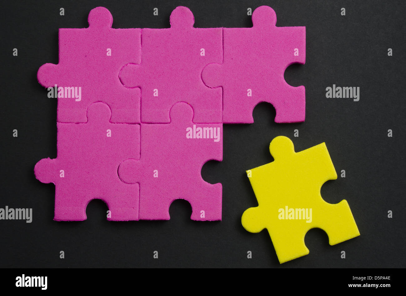 Textured puzzle pieces of different colors, representing tolerance - Stock Image