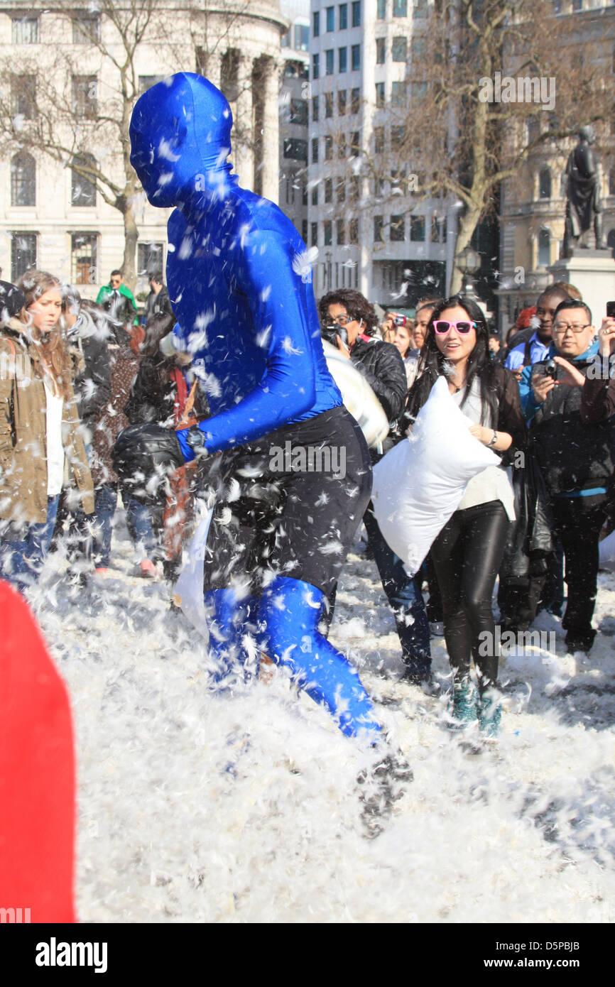 London, UK. 6th April, 2013. Hundreds of people converge on Trafalgar Square to celebrate 'World Pilllow Fight - Stock Image