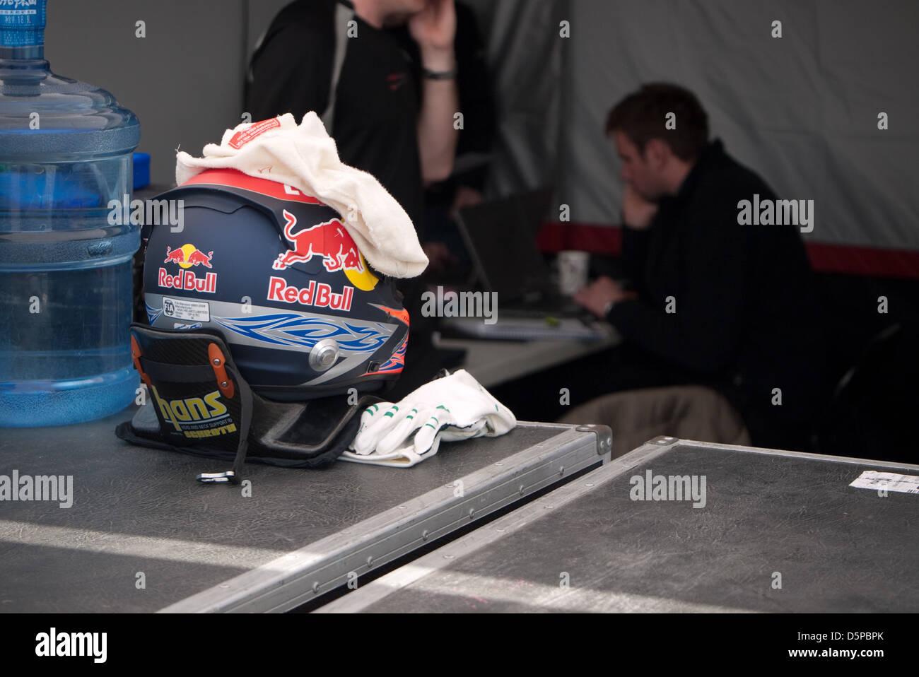 Paddock, racing, helmet with red bull sponsorship, motorsports - Stock Image