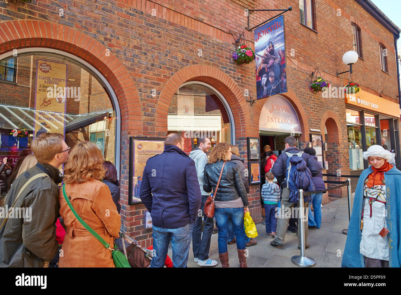 Queue outside the Jorvik Viking Centre, Coppergate  York Yorkshire UK - Stock Image