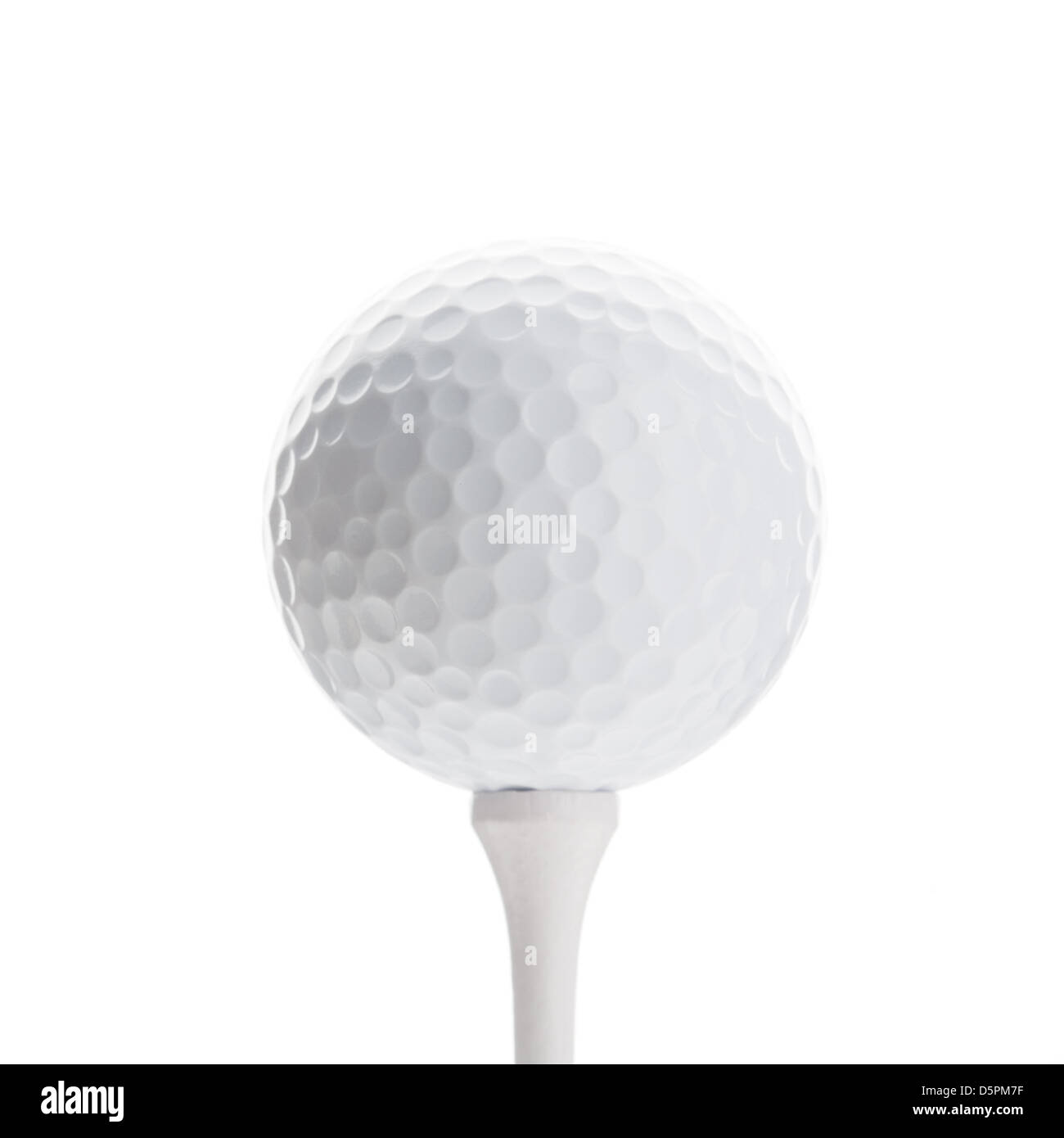 Golfball on white tee, isolated on white - Stock Image