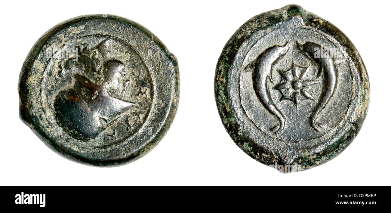 Ancient Syracuse bronze litra coin 344-336 BCE depicting the head of Athena and starfish with dolphins on the reverse - Stock Image