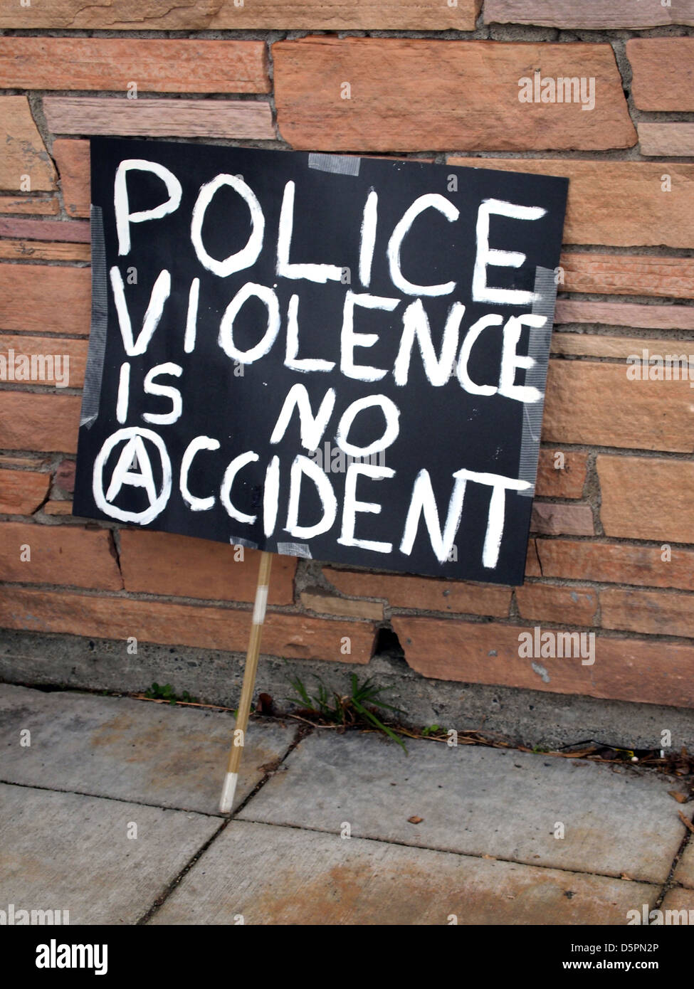 Police violence is no accident anti-police sign at demonstration in Seattle, Washington, USA - Stock Image