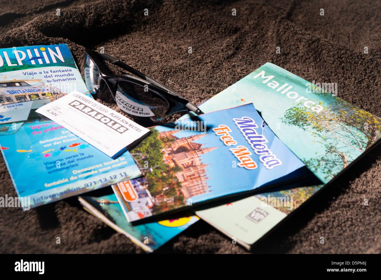 Mallorca holliday brochures on towel - Stock Image