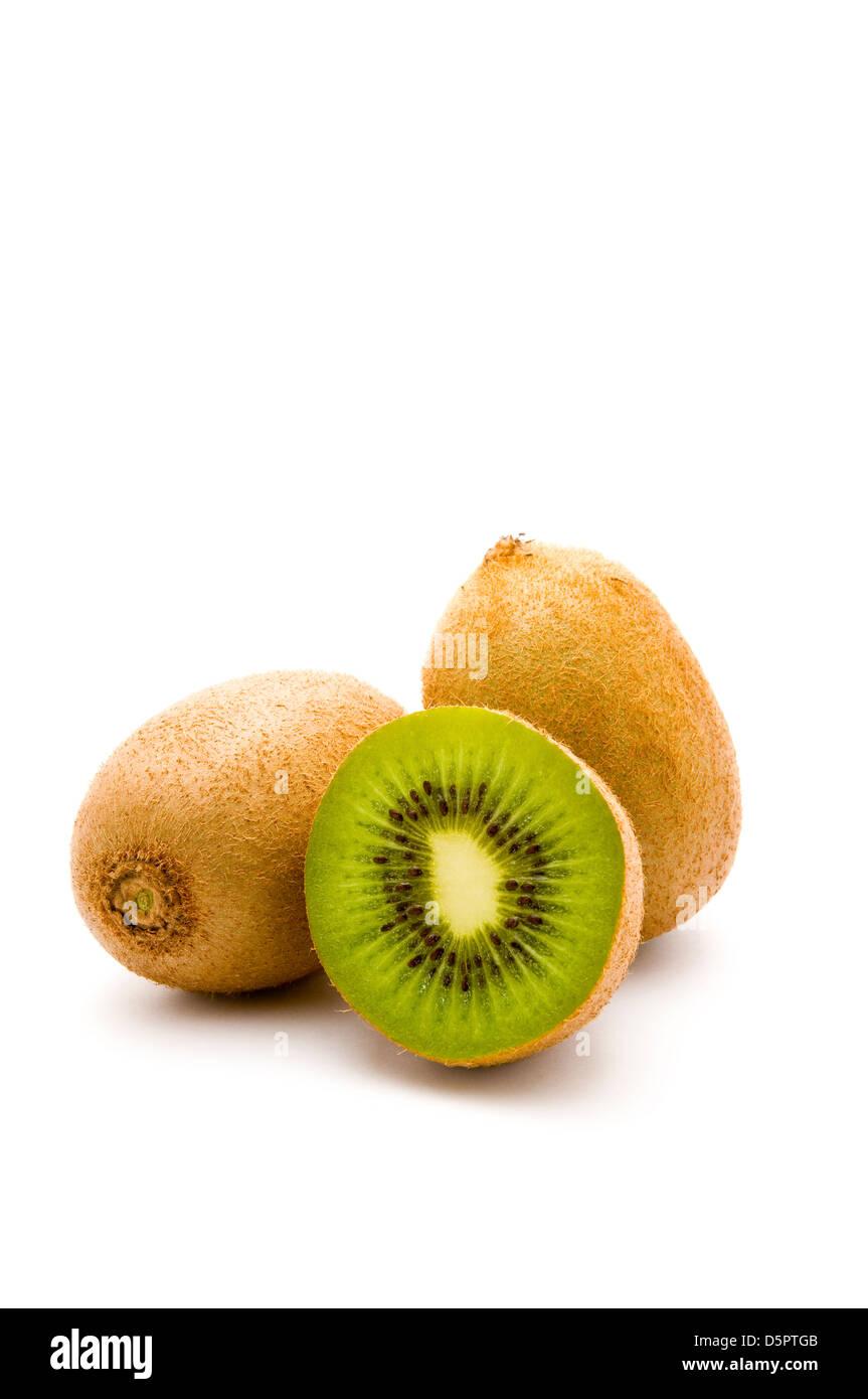 three kiwi fruits isolated on a white background - Stock Image