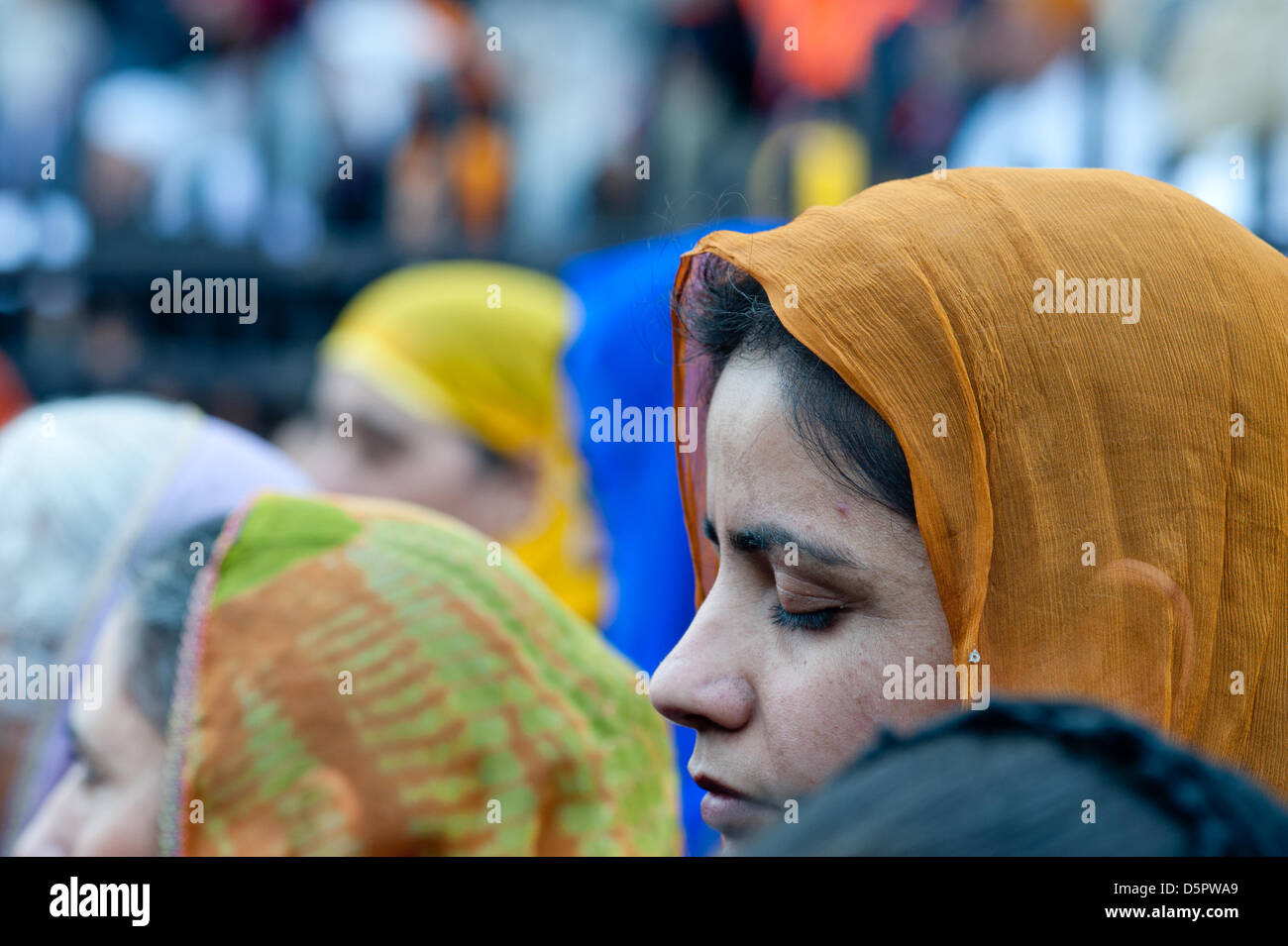London, UK. 7th April 2013. a woman prays with her eyes closed during the Nagar Kirtan celebrations in Southall, - Stock Image