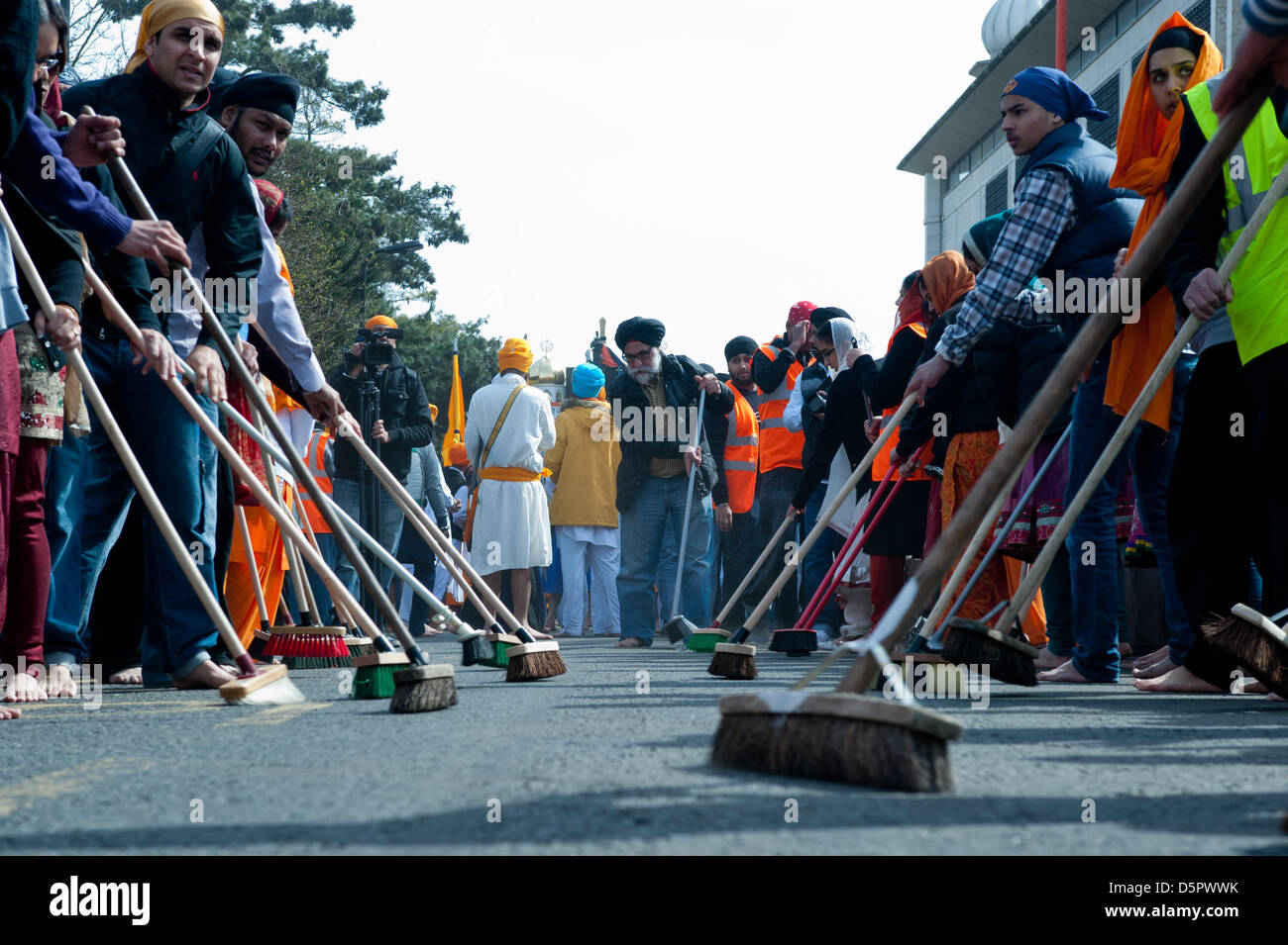 London, UK. 7th April 2013. The road before the procession is cleared by Sewadars during the celebration of Nagar - Stock Image