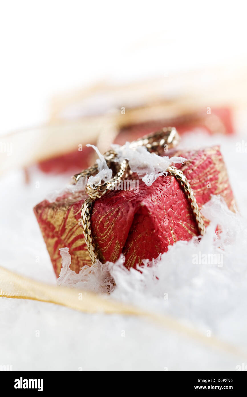 Little chistmas presents on white reflective table Stock Photo