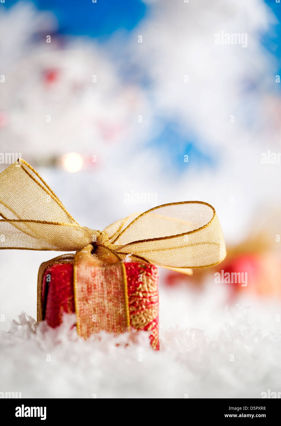 Red christmas gift with beautiful golden ribbon Stock Photo