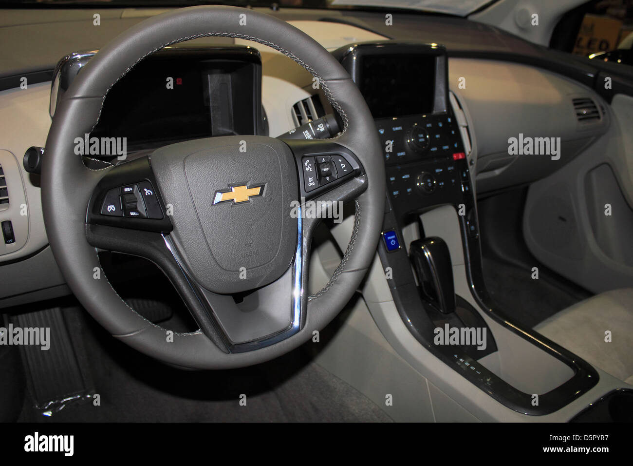 The Interior Dash Steering Wheel In A GMC Chevy Chevrolet Volt Electric  Hybrid Automobile Car