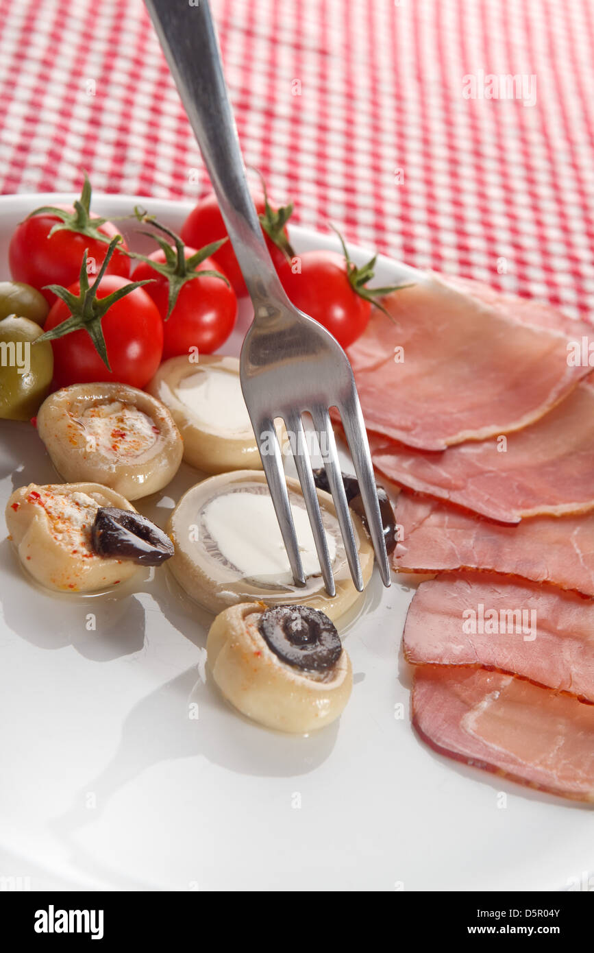 Cold appetizer, plate of assorted cold cuts traditional in mediterranean countries Stock Photo