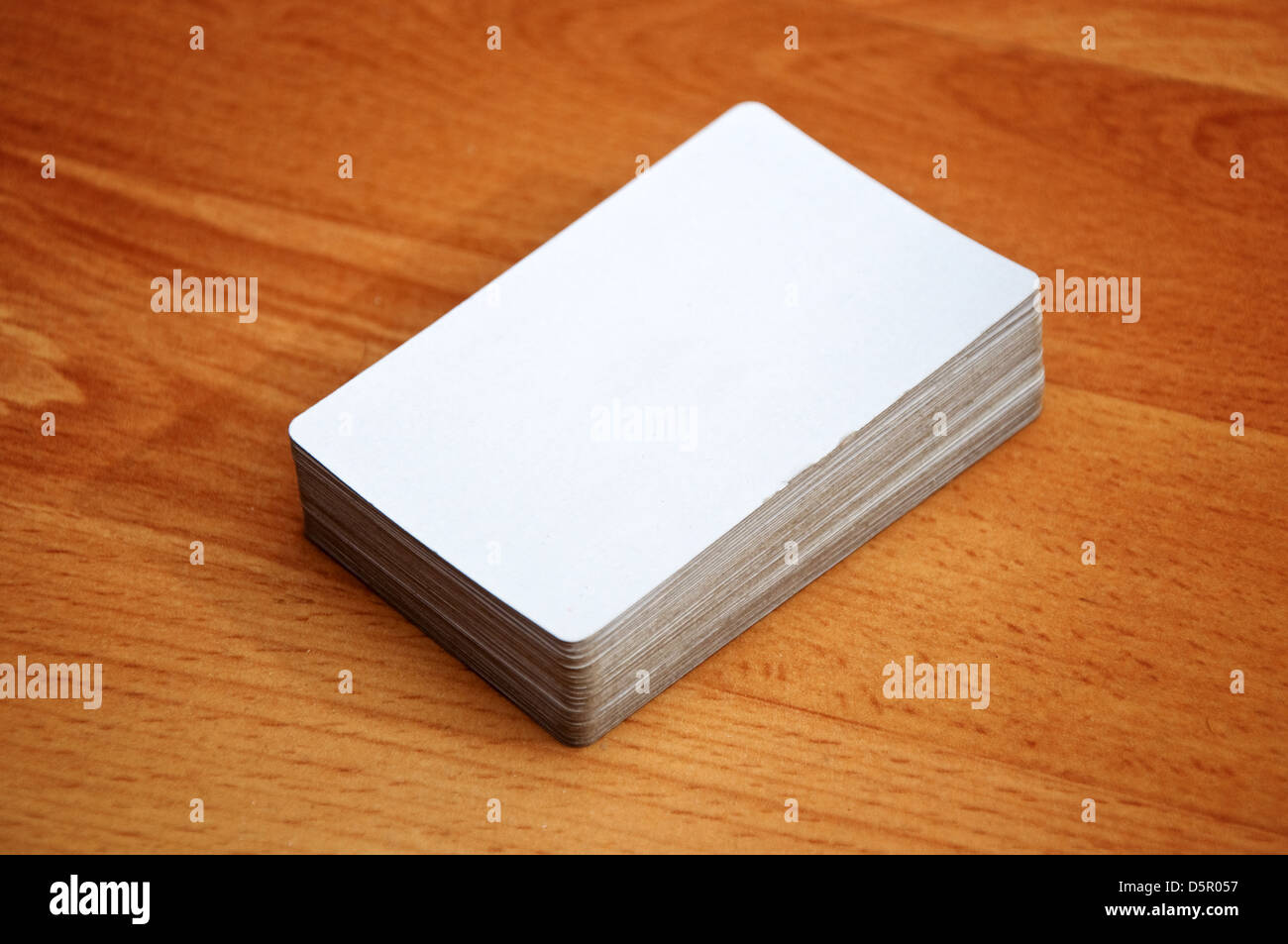Stack of business cards with rounded corners over a wooden stack of business cards with rounded corners over a wooden background reheart Image collections