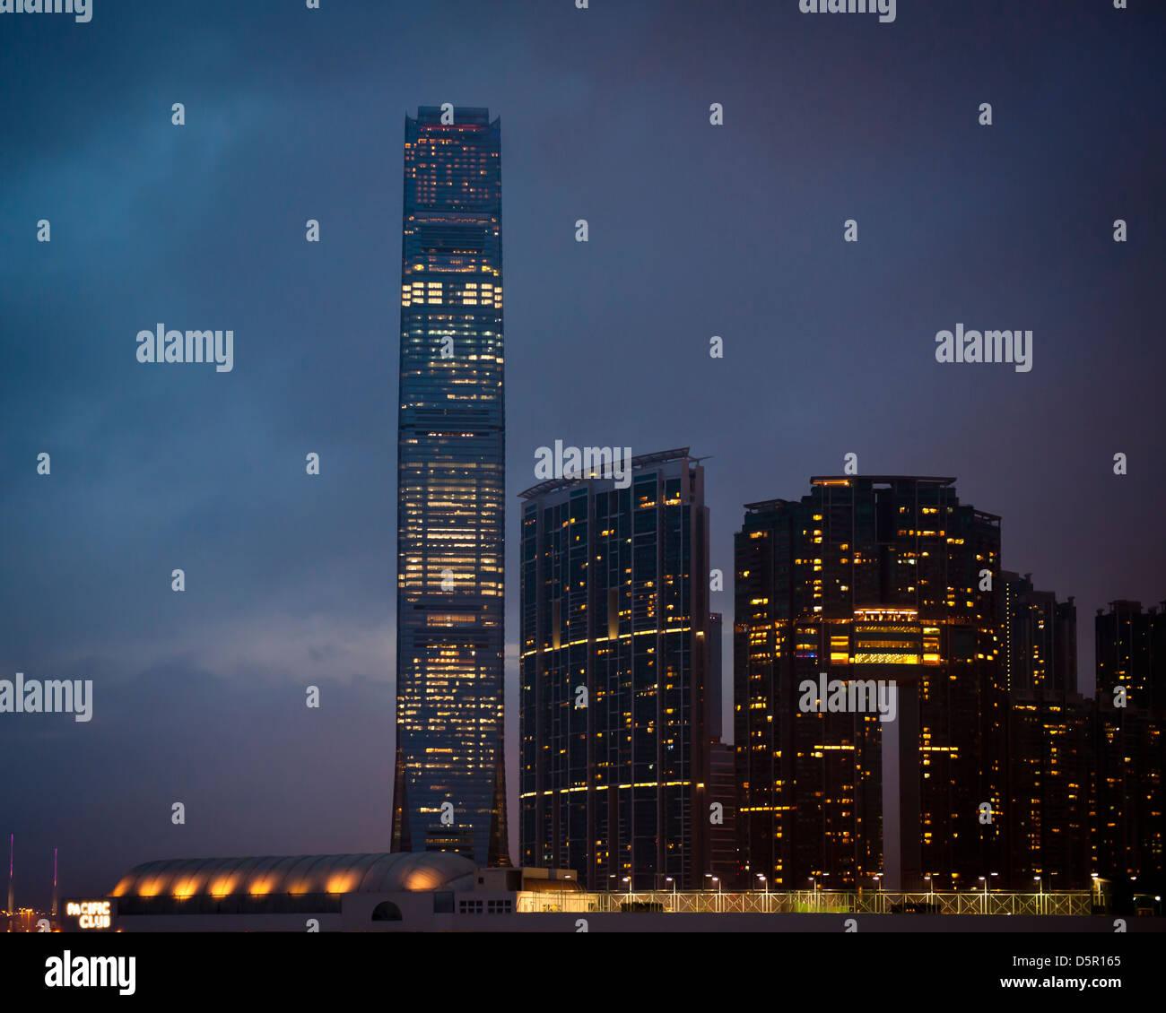 Hong Kong skyscrapers at night. - Stock Image