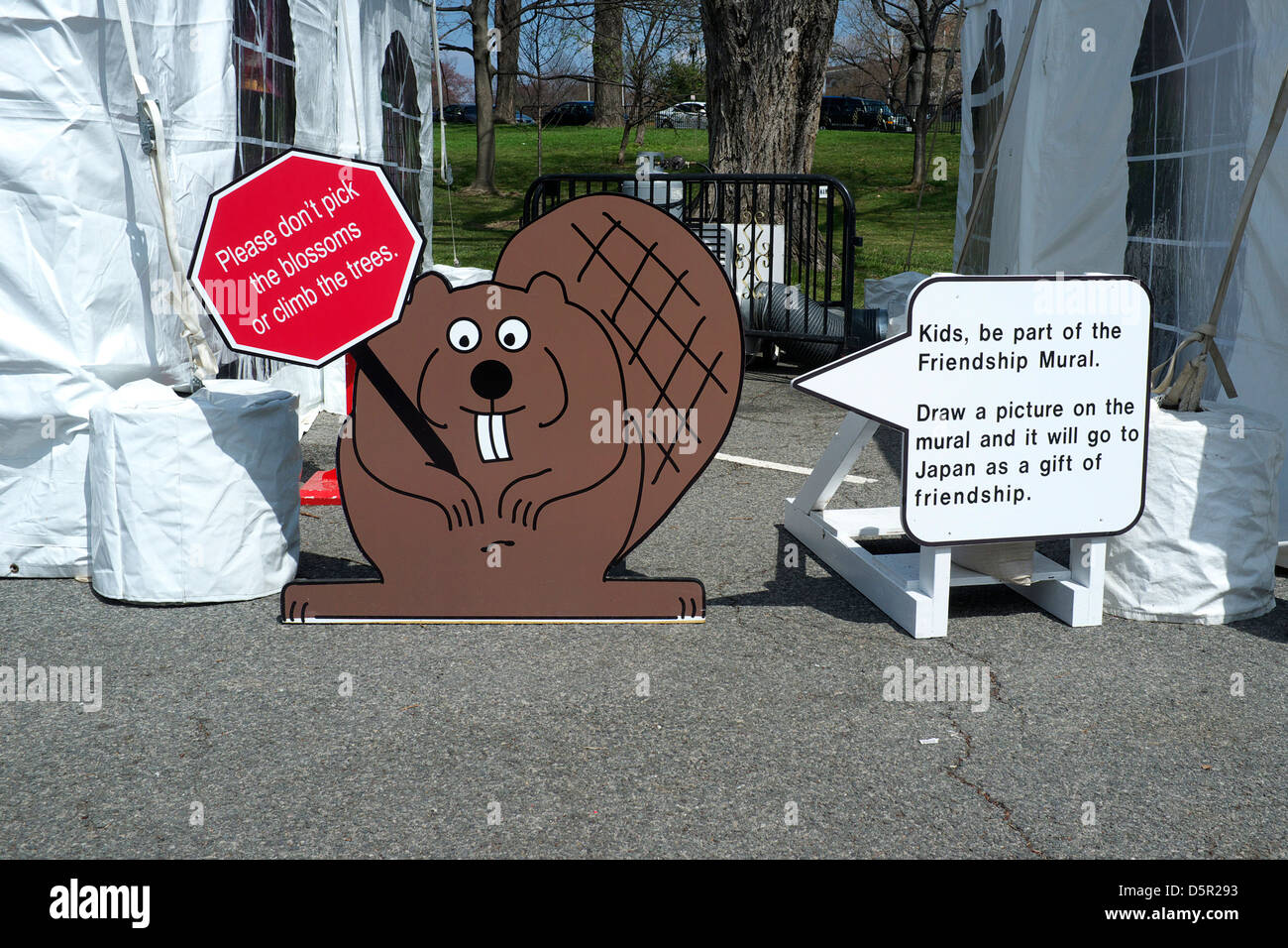 Paddles the Beaver asks you not to pick the blossoms or climb the trees and be part of the friendship mural - gift - Stock Image