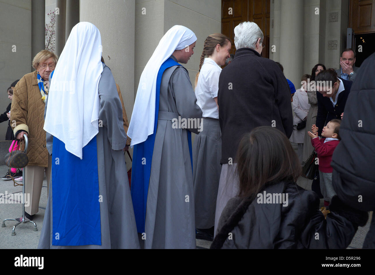 Nuns and churchgoers outside the Basilica of the National Shrine of the Immaculate Conception in Washington DC on Stock Photo
