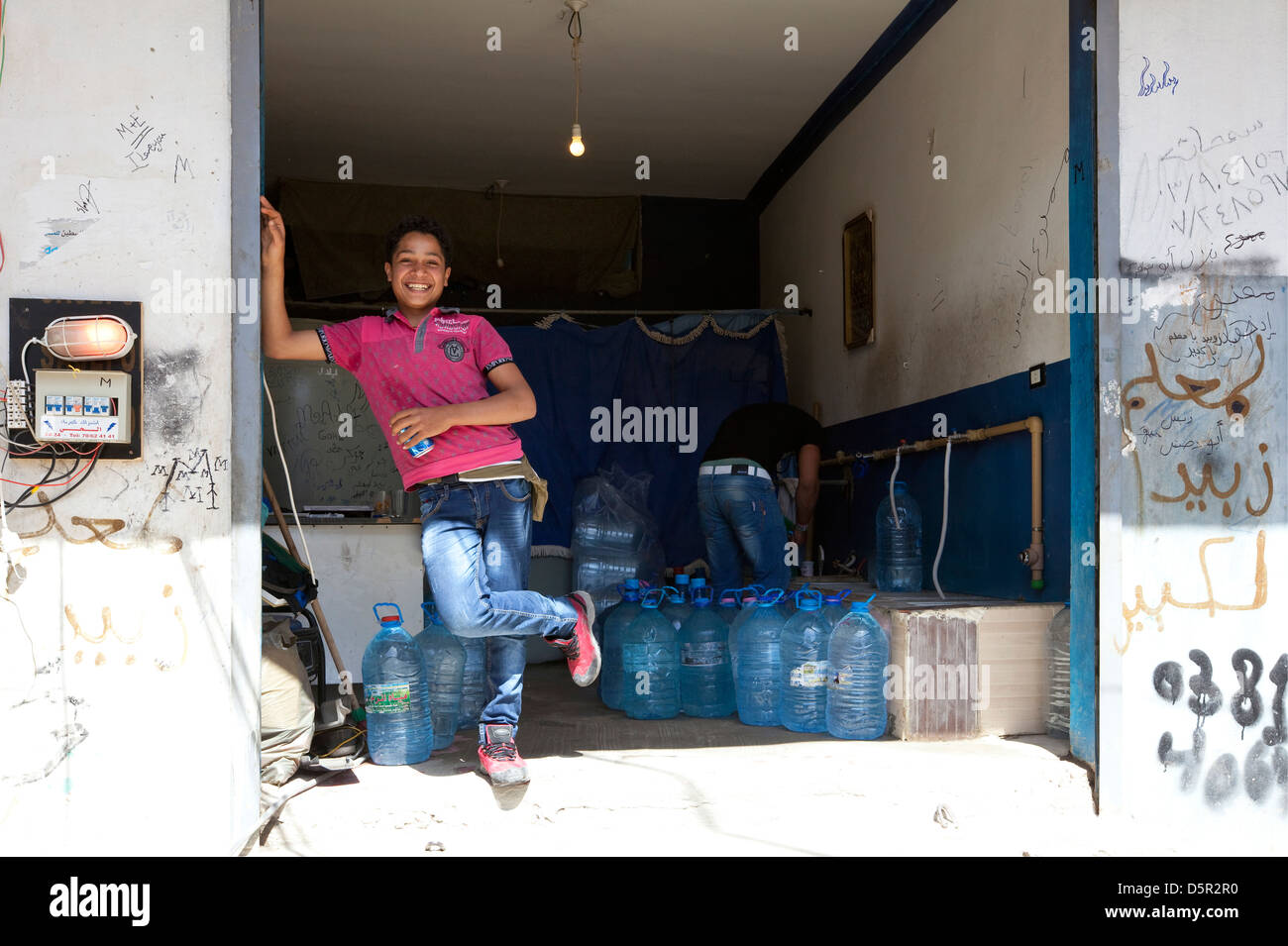 Young Palestinian boy at a water purification plant in Berj El Shamel refugee camp, Tyr, Lebanon - Stock Image