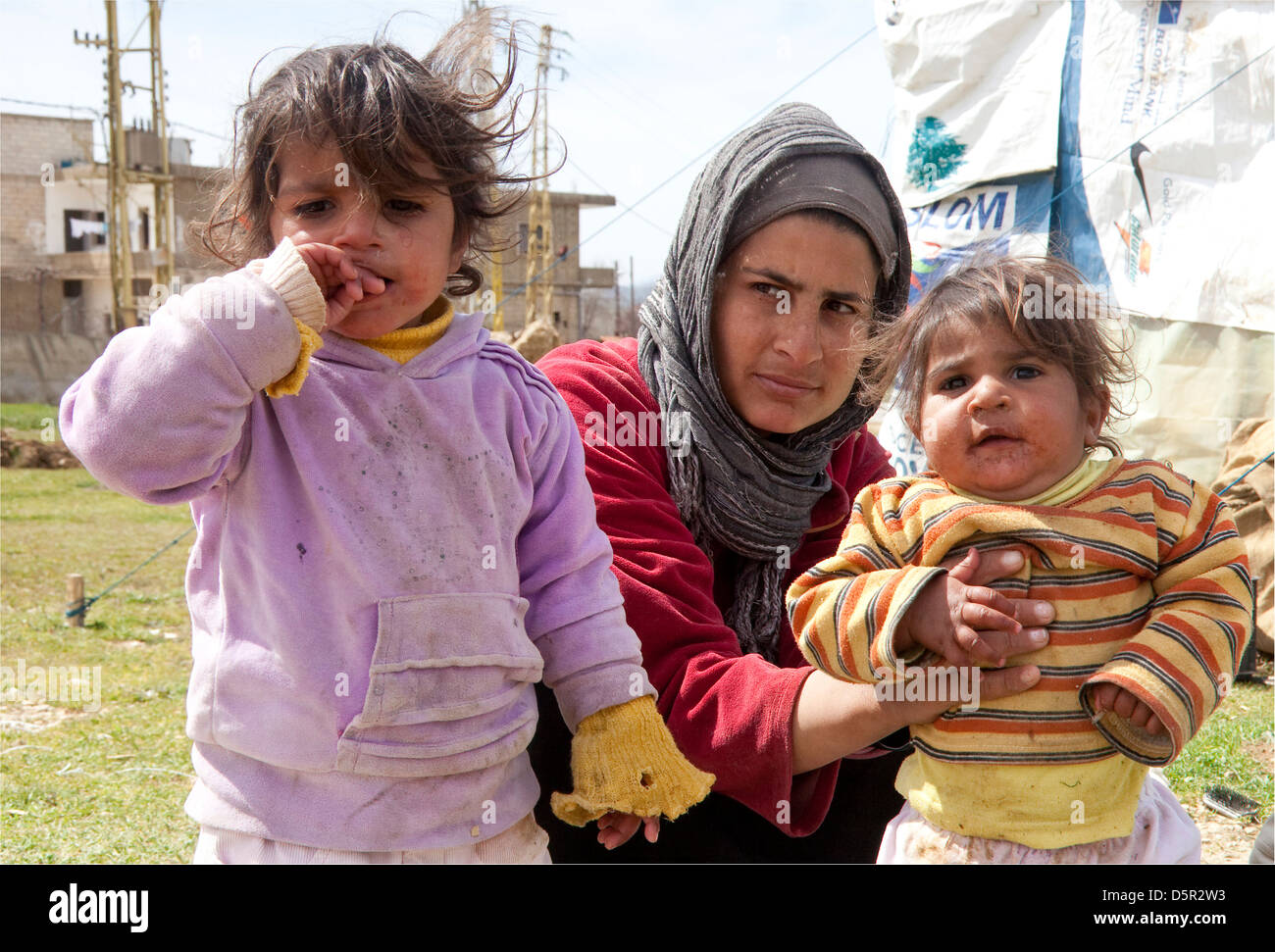Syrian refugee family, near Bekaa Valley Lebanon - Stock Image