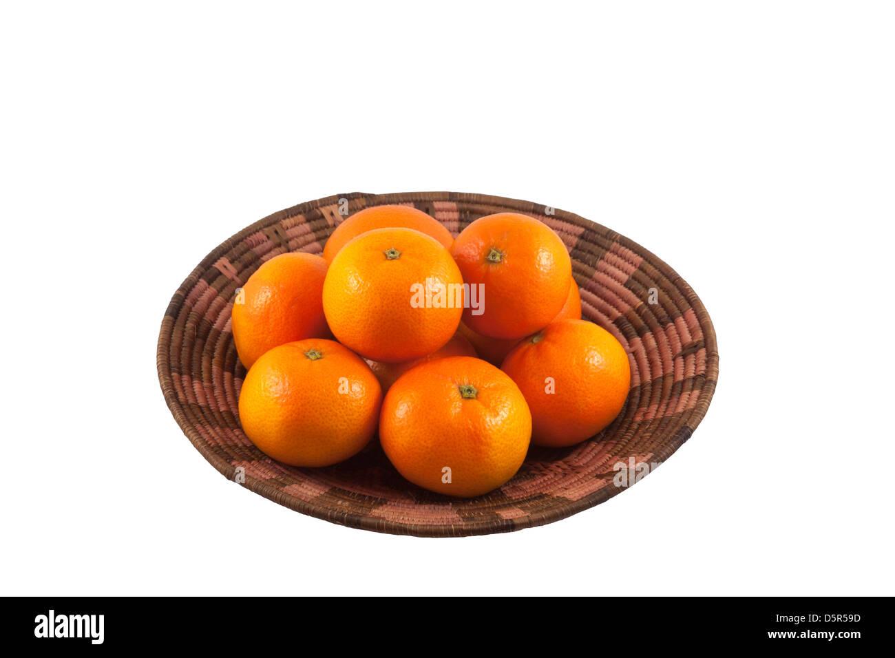 Organic mandarin oranges in African basket - Stock Image
