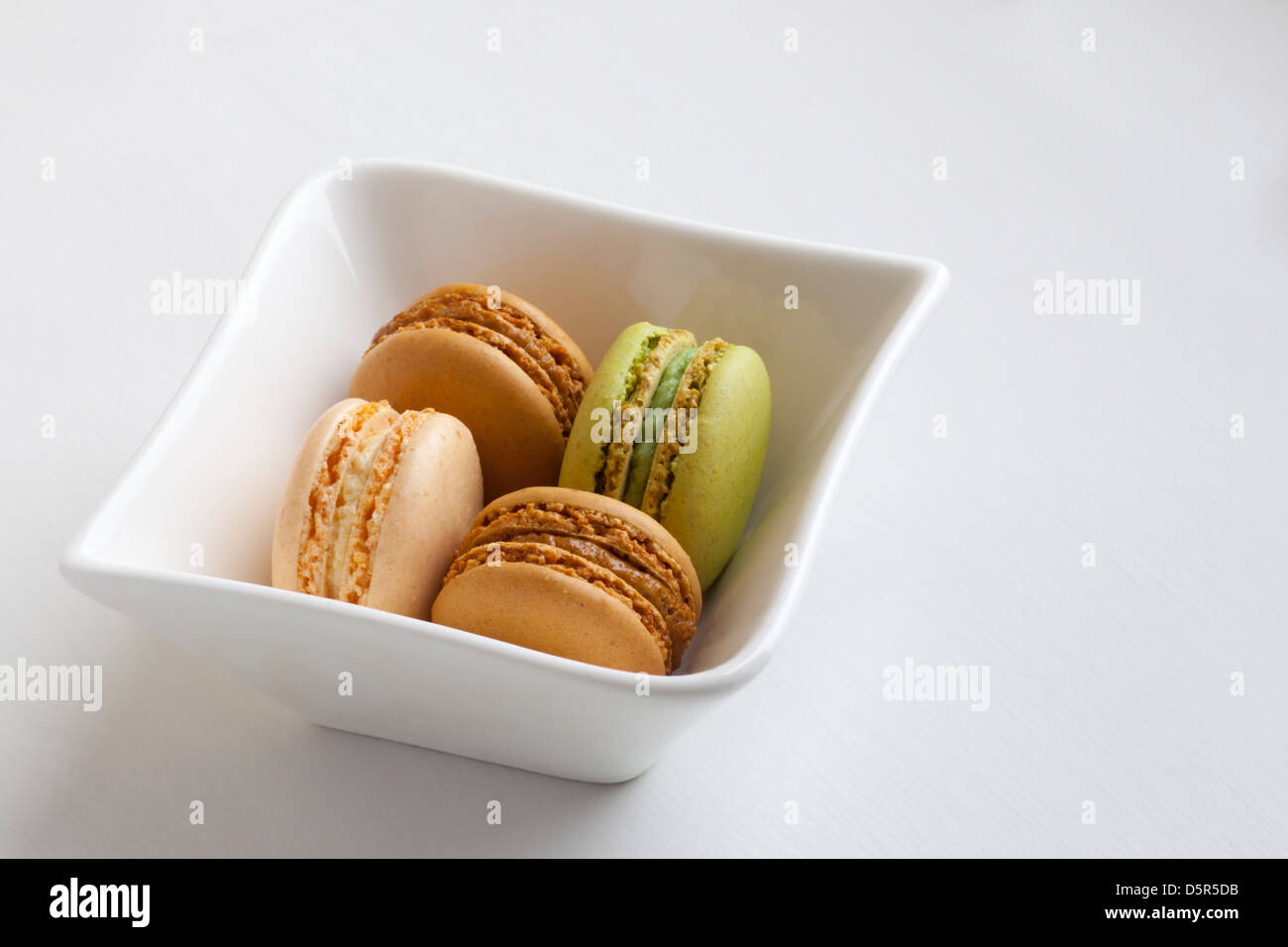 Vanilla, mocha and pistachio flavored imported French macarons at the Fairmont Empress Hotel in Victoria - Stock Image