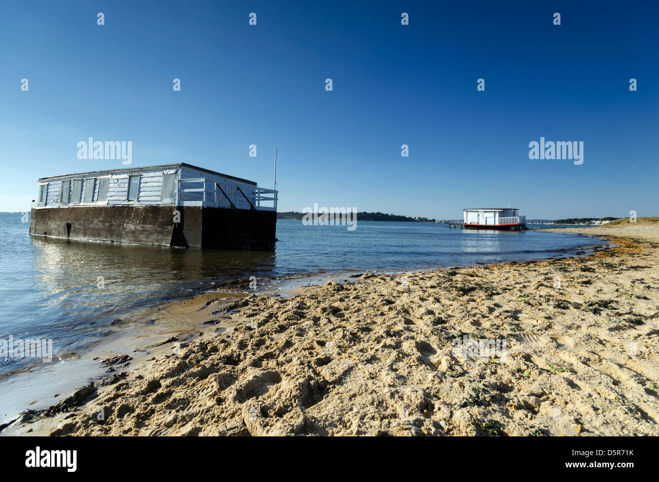 House boat on the beach at Studland in Poole Harbour in Dorset - Stock Image