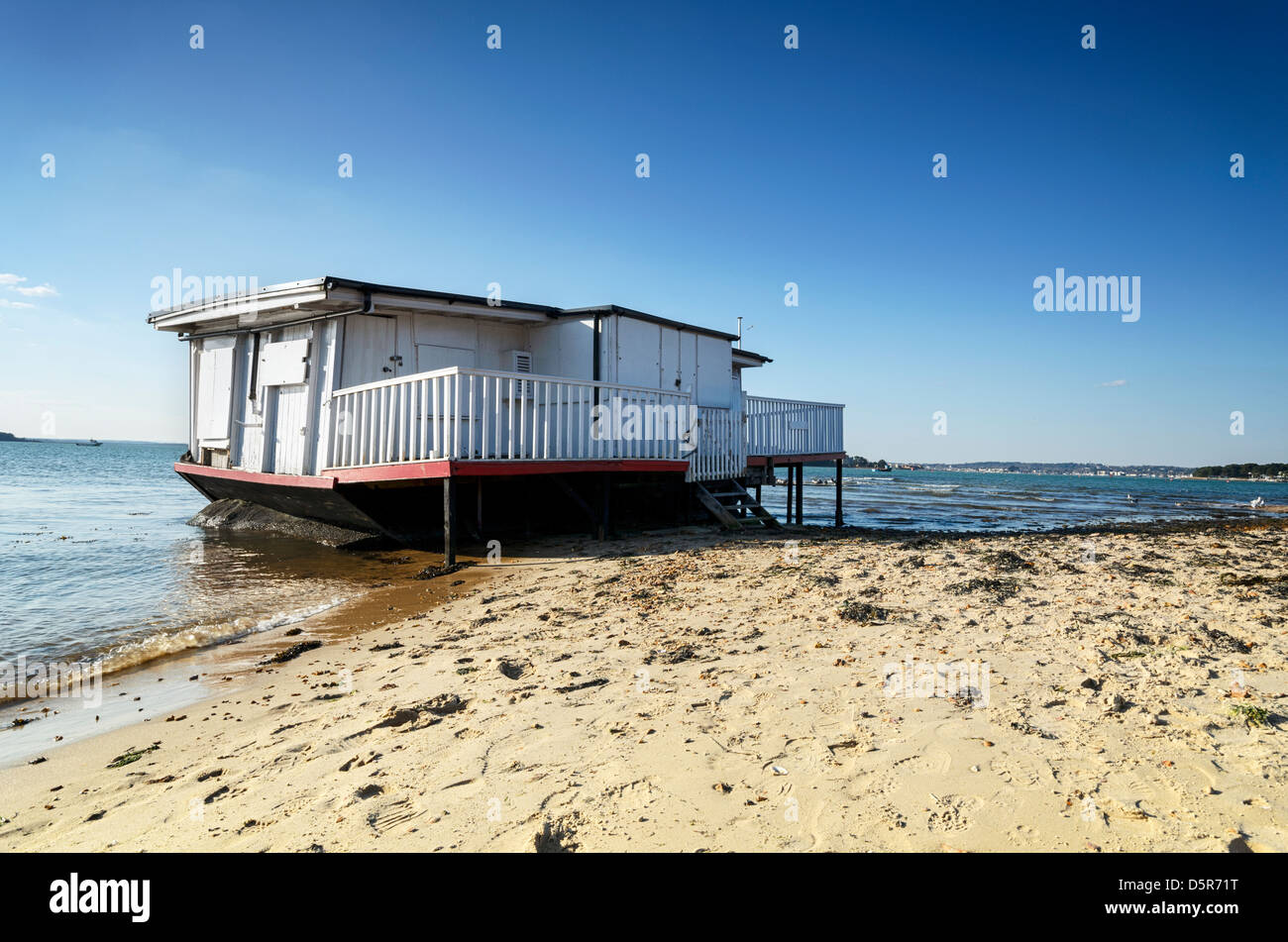 Old house boat on the beach at Studland in Dorset - Stock Image