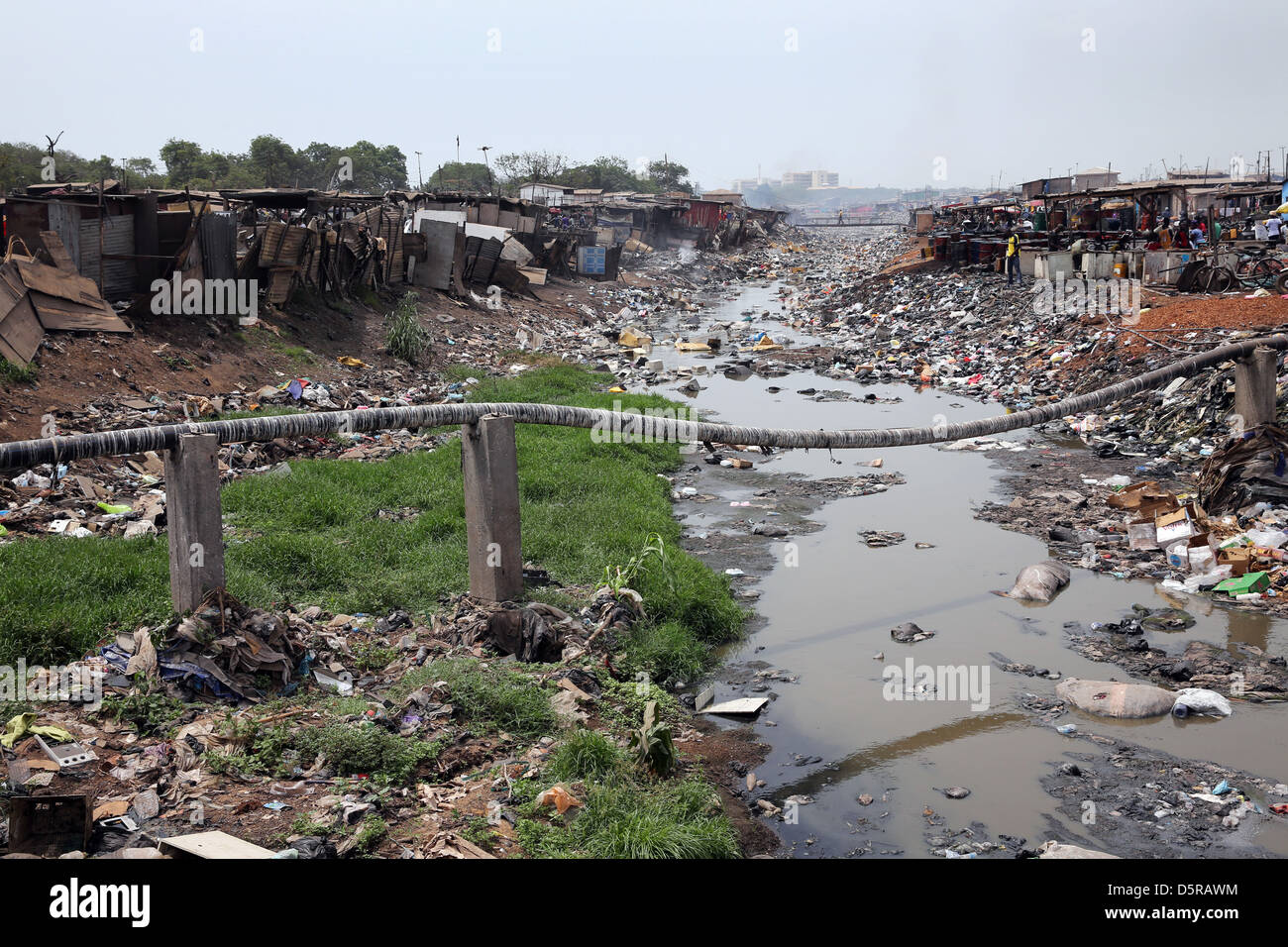 A small river in Accras Agbogbloshie township has become a polluted water body. - Stock Image
