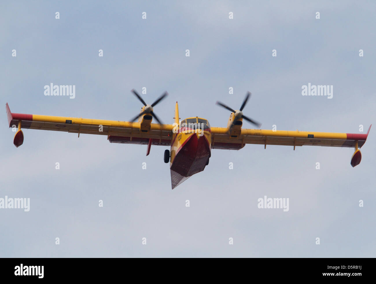 A Canadair fire extinguisher plane is seen during flight - Stock Image