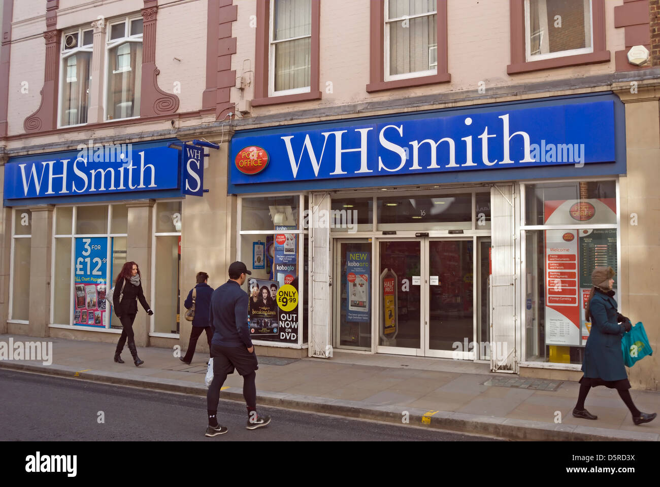pedestrians passing a branch of wh smith in richmond upon thames, surrey, england - Stock Image