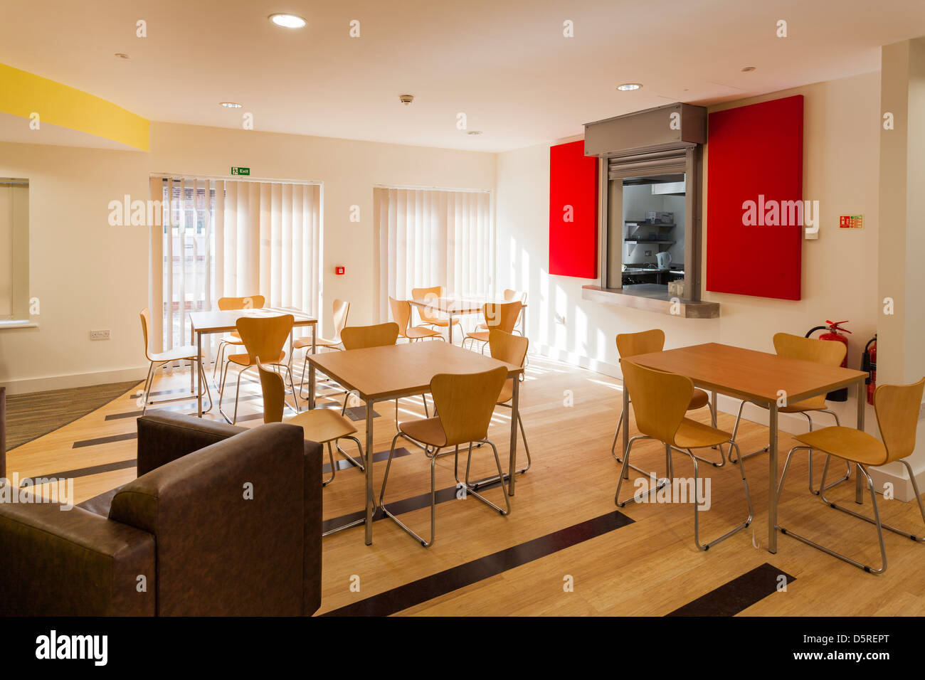shared dining area with hatch to kitchen  at Damascus House and Emmaus House, Salisbury - Stock Image