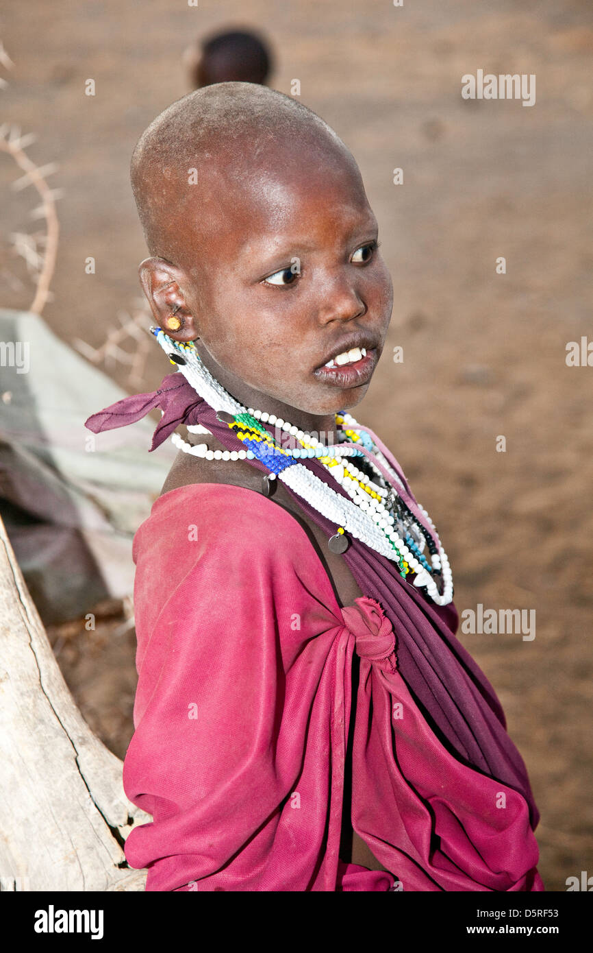 Africa, Tanzania;Maasai women in traditional dress with hand made jewelry - Stock Image