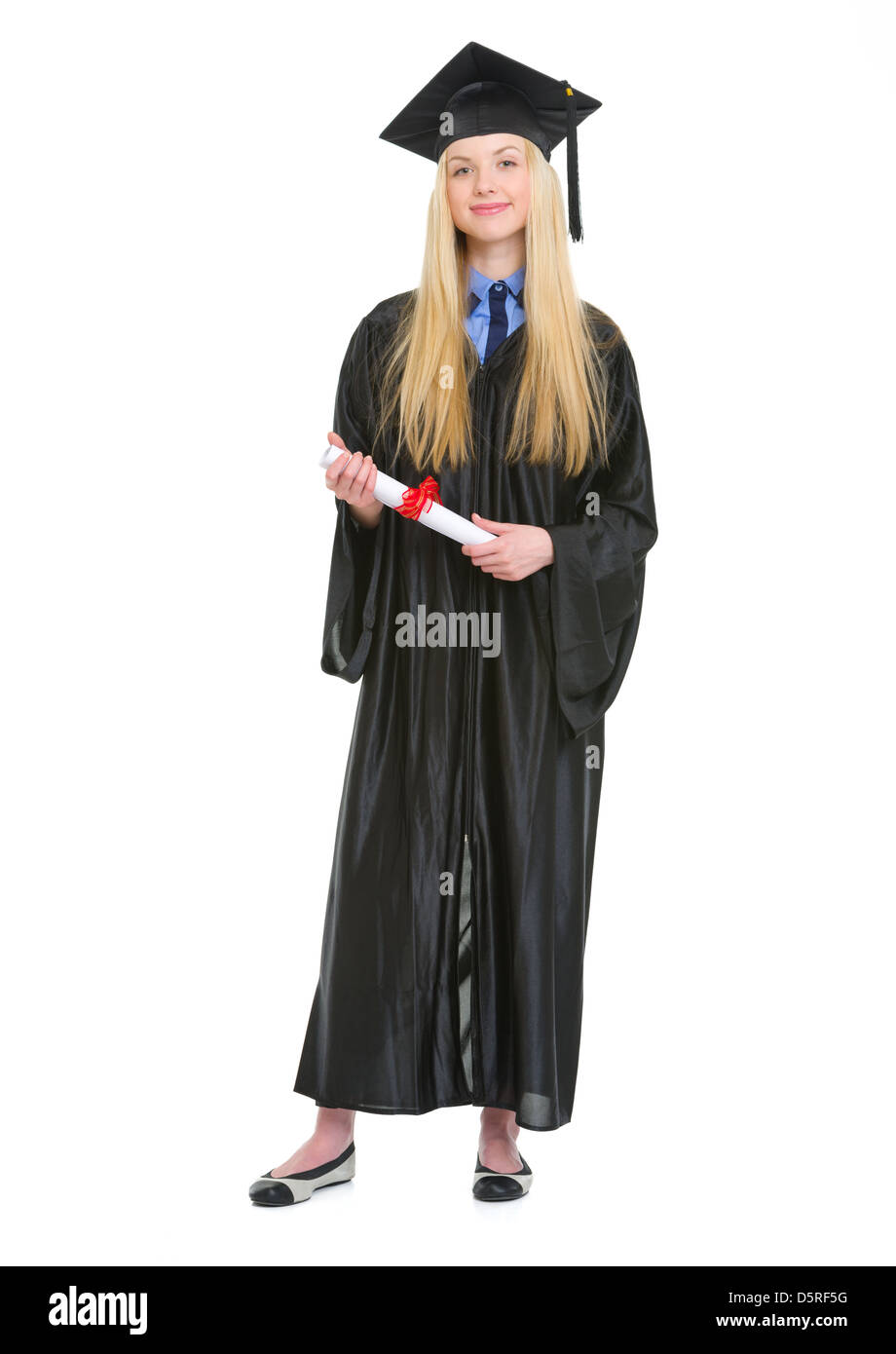 Full length portrait of happy young woman in graduation gown with ...