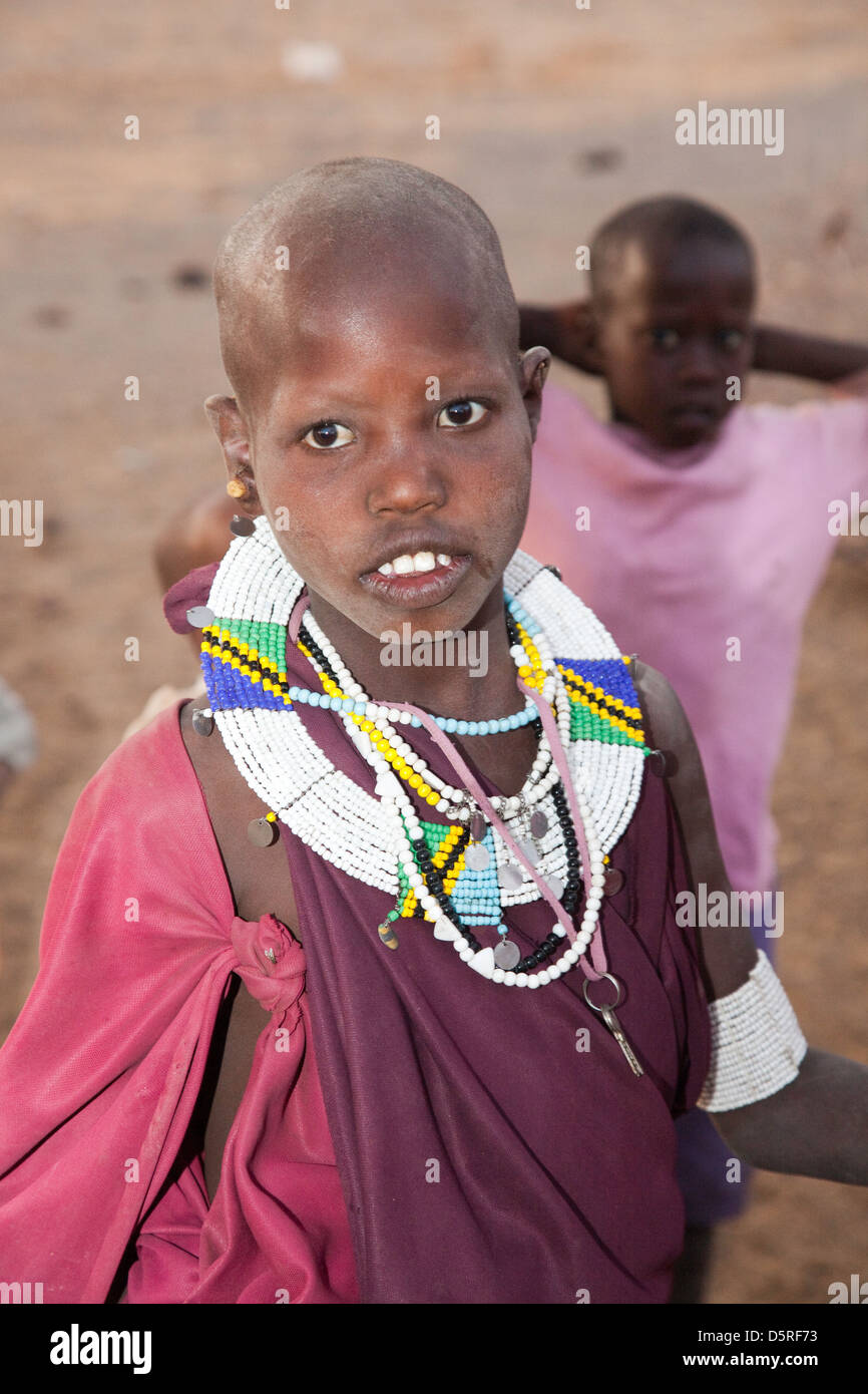 Africa, Tanzania;Young Maasai girl in traditional dress with hand made jewelry - Stock Image