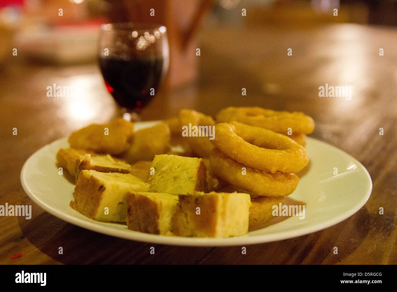 Tapas and a glass of red wine - Stock Image