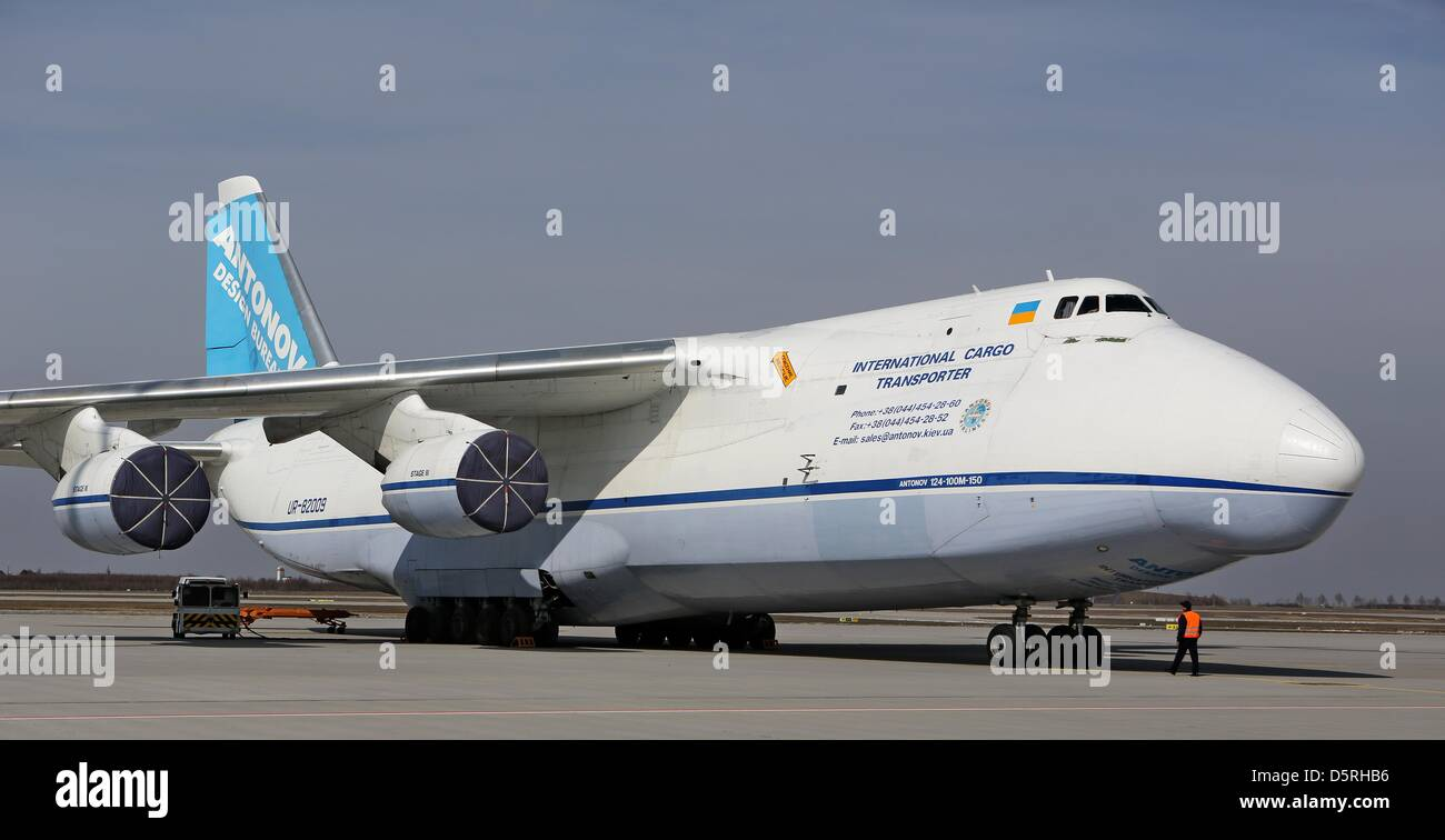 An employee stands in front of an Antonov An-124 at Leipzig/Halle Airport in Schkeuditz, Germany, 08April 2013. Stock Photo